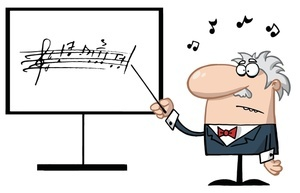 a_music_professor_pointing_to_a_song_written_on_a_whiteboard_0521-1005-1515-0758_SMU